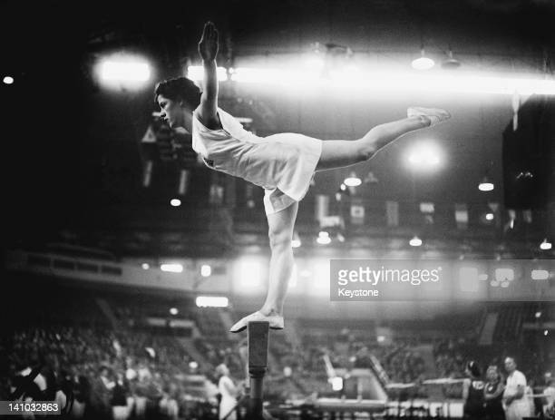 Cissie Davies of Great Britain on the balance beam at Empress Hall Earl's Court during the gymnastics events at the London Olympic Games 12th August...