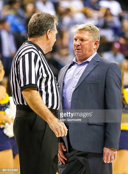 Citadel Bulldogs head coach Duggar Baucom speaks with an official during the second half of the NCAA basketball game between The Citadel Bulldogs and...