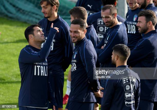 Citadin Martins Eder and Danilo D'Ambrosio of Italy chat prior to the training session at Italy club's training ground at Coverciano on November 7...