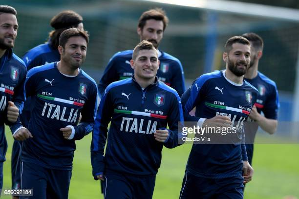 Citadin Martins Eder Marco Verratti and Antonio Candreva of Italy chat during the training session at the club's training ground at Coverciano on...