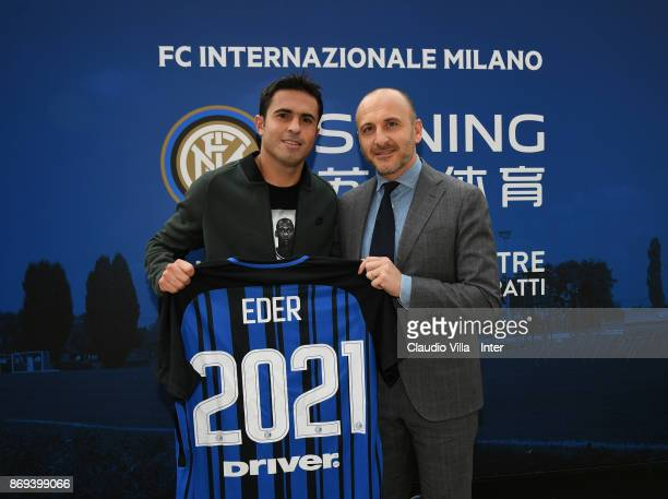 Citadin Martins Eder of FC Internazionale and Sportif Director of FC Internazionale Milano Piero Ausilio pose for a photo after the FC Internazionale...