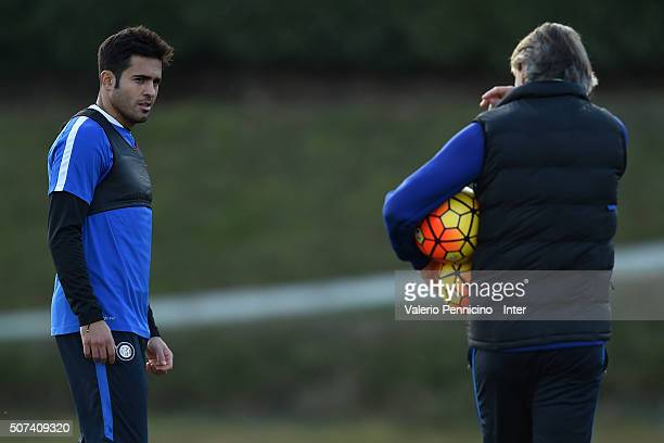 Citadin Martins Eder of FC Internazionale Milano listens to the instructions of the head coach Roberto Mancini during FC Internazionale training...