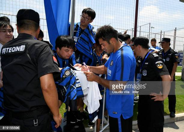 Citadin Martins Eder of FC Internazionale signs autographs for fans after a FC Interazionale training session at Suning training center on July 20...