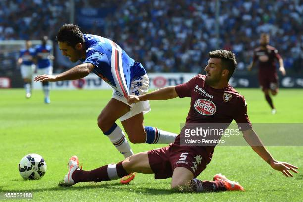 Citadin Martins Eder of UC Sampdoria is pulled by his shirt by Cesare Bovo of Torino FC during the Serie A match between UC Sampdoria and Torino FC...