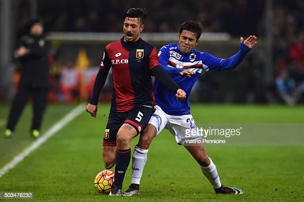 Citadin Martins Eder of UC Sampdoria tackles Armando Izzo of Genoa CFC during the Serie A match between Genoa CFC and UC Sampdoria at Stadio Luigi...