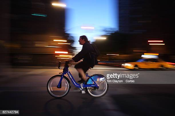 A Citi Bike user at night time in Chelsea Manhattan New York Citi Bike the NYC Bicycle Share Program sponsored by Citi Bank launched in late May 2013...