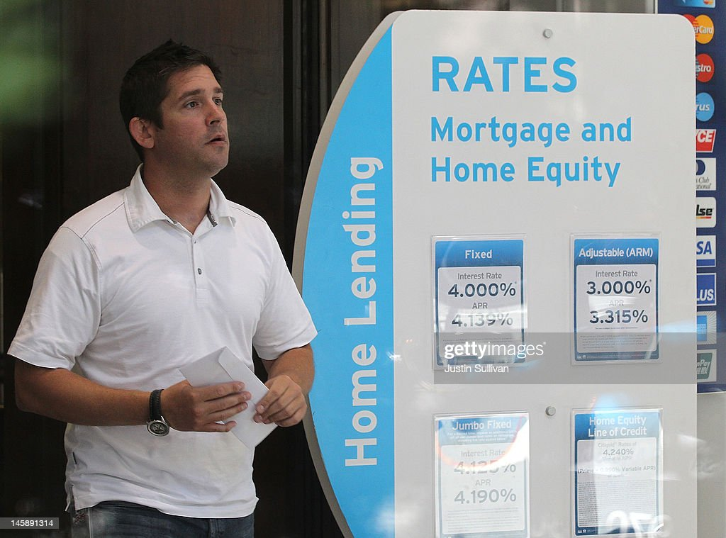 A Citibank customer walks by a sign displaying mortgage rates inside a Citibank office on June 7, 2012 in San Francisco, California. Average rates for 30 and 15 year fixed mortgages fell for the sixth straight week to record lows. The 30 year loan fell to 3.67 percent from 3.75 percent last week and the 15 year mortgage dropped to 2.94 percent compared 2.97 percent one week ago.
