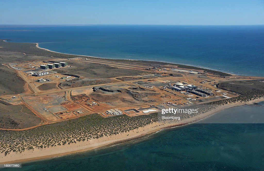 Citic Pacific Ltd.'s port facility used for serving the company's Sino Iron project stands under construction in this aerial photograph taken over Karratha, Western Australia, on Monday, Aug. 20, 2012. Australian mining tycoon Clive Palmer expects to receive $500 million a year in royalties from Citic Pacific's $8 billion iron ore mine in Western Australia once it reaches full production. Photographer: Carla Gottgens/Bloomberg via Getty Images
