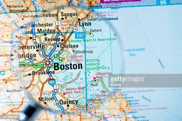 Cities under magnifying glass on map: Boston