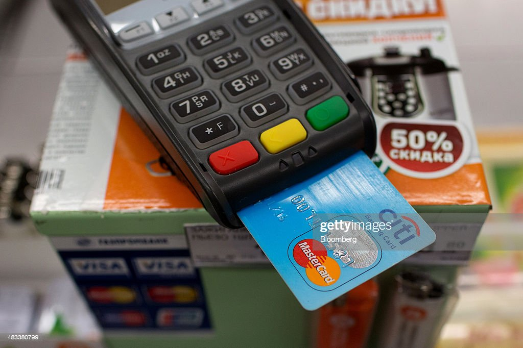 A Citigroup Inc. banking card with a Mastercard Inc. logo sits in a payment machine at the cash desk inside a Dixy supermarket operated by OAO Dixy Group in Moscow, Russia, on Tuesday, April 8, 2014. Suppliers suffering from ruble depreciation this quarter are urging retailers to increase prices. Photographer: Andrey Rudakov/Bloomberg via Getty Images