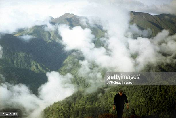 US citizen Butch Zein of California ascends a mountain trail in Sikkim state in eastern India near the border of Tibet 01 October 2004 The Dzongri...