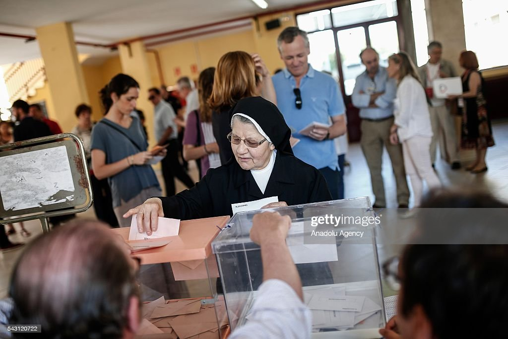 A citizen casts her ballot at a polling station during the Spanish general election in Madrid, Spain on June 26, 2016.