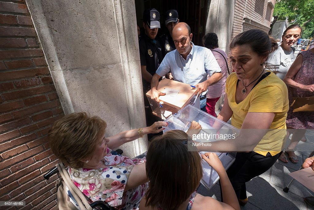 Citizen casts her ballot at a polling station during the Spanish general election in Madrid, Spain on June 26, 2016. Spain votes today, six months after an inconclusive election which saw parties unable to agree on a coalition government.