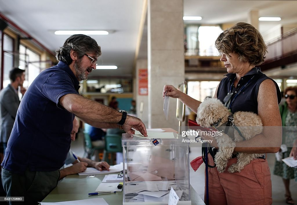 A citizen casts his ballot at a polling station during the Spanish general election in Madrid, Spain on June 26, 2016.