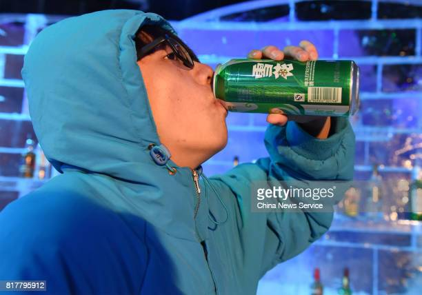 A citizen drinks wine at the ice bar on July 17 2017 in Chongqing China Minus 10 degrees ice bar cools citizens down and helps them escape heat...