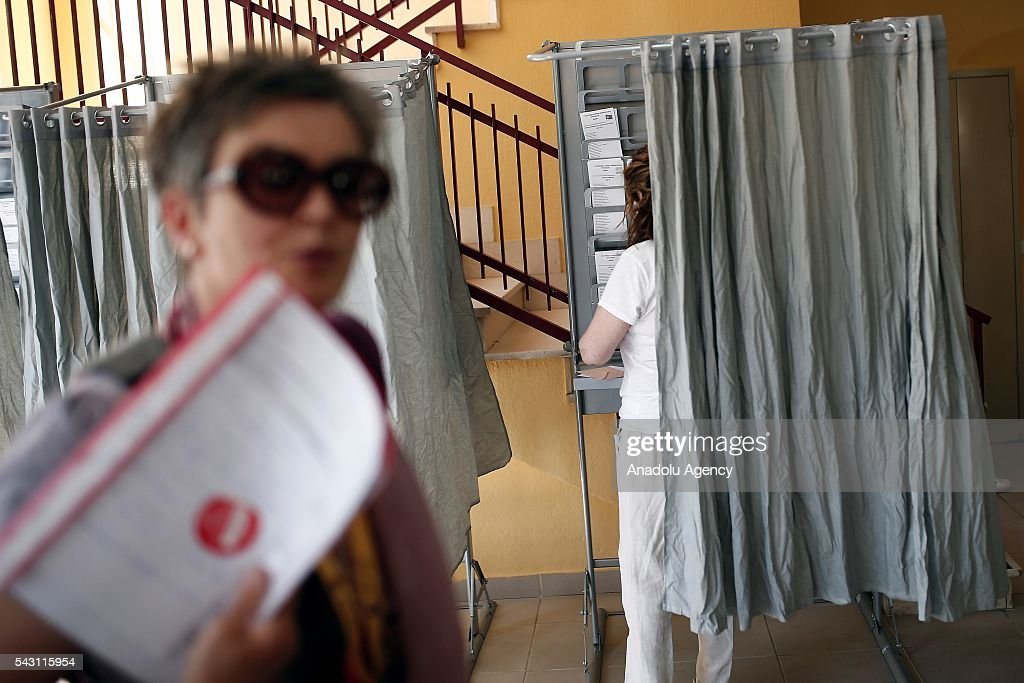 A citizen is seen in a polling booth before casting her ballot at a polling station during the Spanish general election in Madrid, Spain on June 26, 2016.