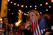 A US citizen listens spellbound to Barack Obama's inauguration speech Along with other members of expatriate 'Democrats Abroad' party supporters she...