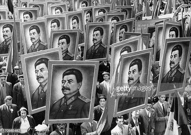 Citizen marchers carrying posters of joseph stalin at a may day parade in bucharest romania 1950s