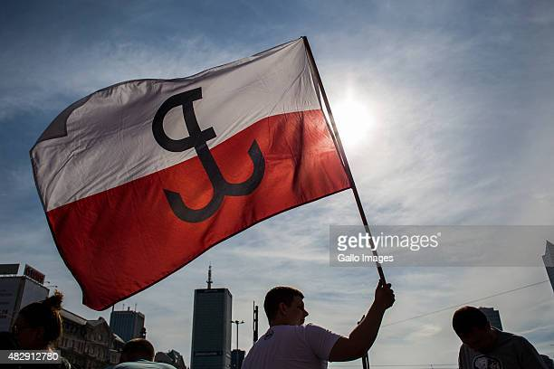 A citizen of Warsaw waves the Polish flag with an Anchor during the celebration of the 71th anniversary of the Warsaw Uprising on August 1 2015 in...