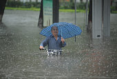 A citizen pulls his bicycle in deep ponding on July 19 2016 in Taiyuan Shanxi Province of China Heavy rainstorm stroke west China's Taiyuan City...