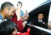 A citizen takes a selfie with Turkey's President Recep Tayyip Erdogan as Erdogan leaves the Presidential Complex in Ankara Turkey on July 22 2016