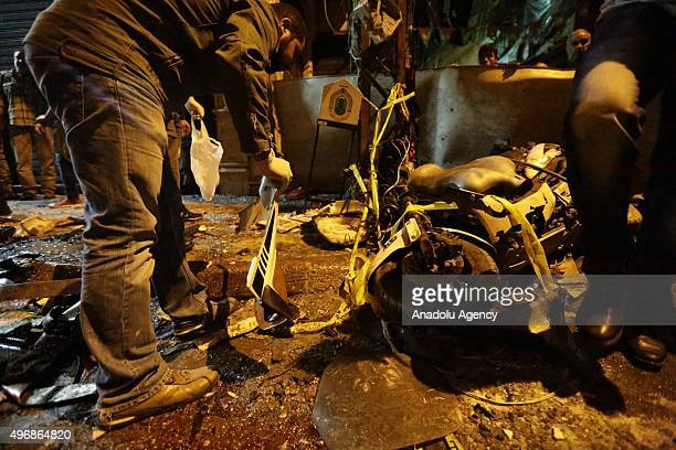 Citizens and civil defense teams examine the place that two explosions took place at Dahieh known as Hezbollah stronghold South Beirut Lebanon on...