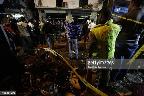 Citizens and civil defense teams examine the place that two explosions took place at Dahieh know as Hezbollah stronghold South Beirut Lebanon on...