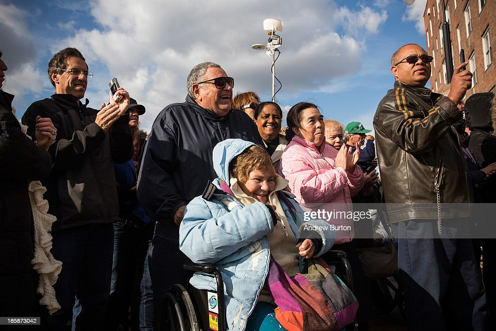 Citizens attend a ceremony to officially reopen the Long Beach boardwalk on October 25, 2013 in Long Beach, New York. The boardwalk was severely damaged by Superstorm Sandy last year, which killed 285 people and caused billions of dollars in damage. Long Beach's new boardwalk is made of Brazilian hardwood and is estimated to have a lifespan of 30-40 year; the previous boardwalk was only scheduled to last three to seven years.
