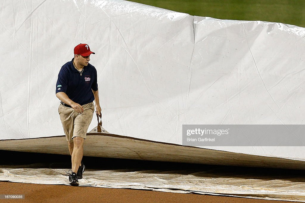 Citizens Bank Park Grounds Crew member pulls the tarp onto the infield for a rain delay that led to the game being called in the seventh inning of the game between the St. Louis Cardinals and the Philadelphia Phillies on April 19, 2013 in Philadelphia, Pennsylvania. The Phillies won 8-2.