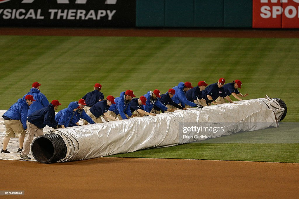 Citizens Bank Park Grounds Crew roll out the tarp for a rain delay in the seventh inning of the game between the St. Louis Cardinals and the Philadelphia Phillies on April 19, 2013 in Philadelphia, Pennsylvania.