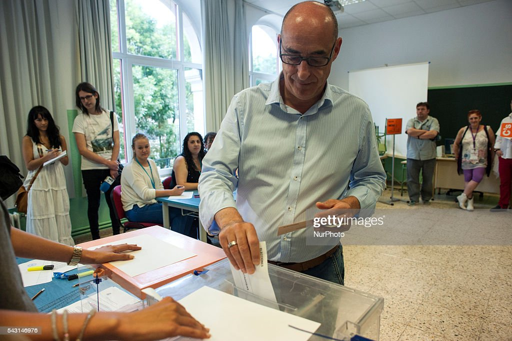 Citizens candidate Felix Alvarez puts his vote at a polling station in Santander . Spanish voters head back to the polls after the last election in December failed to produce a government. Latest opinion polls suggest the Unidos Podemos left-wing alliance could make enough gains to come in second behind the ruling center right Popular Party.