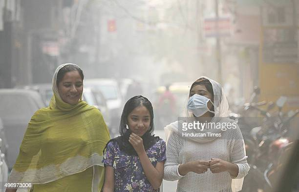 Citizens cover their faces while going out on a smoggy morning on November 13 2015 in New Delhi India Pollution soared to hazardous levels in Delhi...
