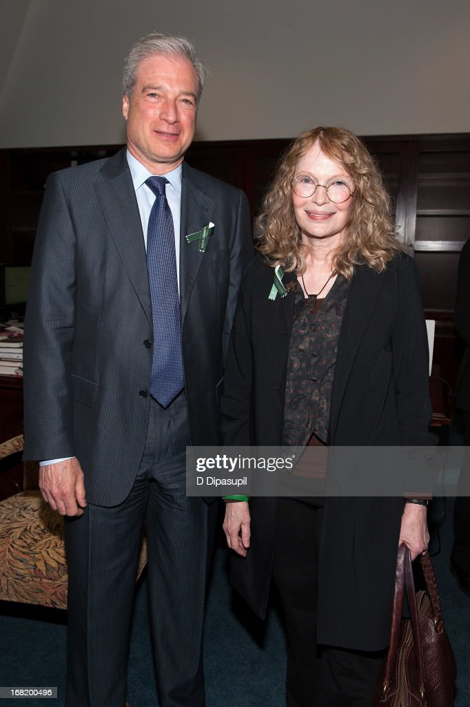 Citizens Crime Commission of New York City president Richard Aborn (L) and <a gi-track='captionPersonalityLinkClicked' href=/galleries/search?phrase=Mia+Farrow&family=editorial&specificpeople=93764 ng-click='$event.stopPropagation()'>Mia Farrow</a> attend the Newtown Memorial Concert at Gerald W. Lynch Theatre on May 6, 2013 in New York City.