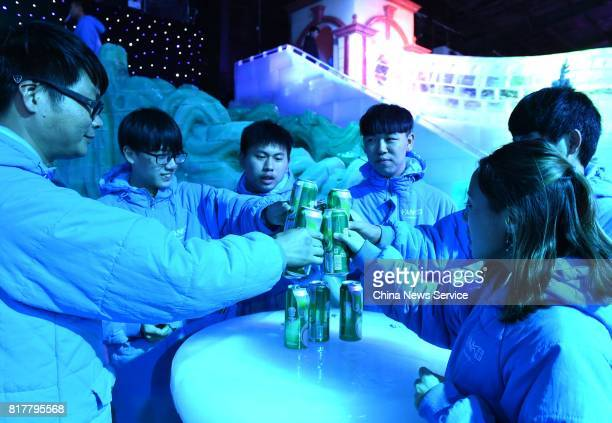 Citizens drink wine at the ice bar on July 17 2017 in Chongqing China Minus 10 degrees ice bar cools citizens down and helps them escape heat...