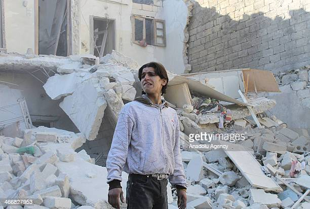 Citizens inspect the rubble of destroyed buildings following the barrel bombattacks of Syrian air forceson February 4 in Aleppo Syria At least 27...