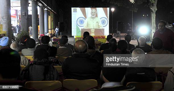 Citizens listening to the speech of PM Narendra Modi on December 31 2016 in Chandigarh India Prime Minister Narendra Modi made many announcements...