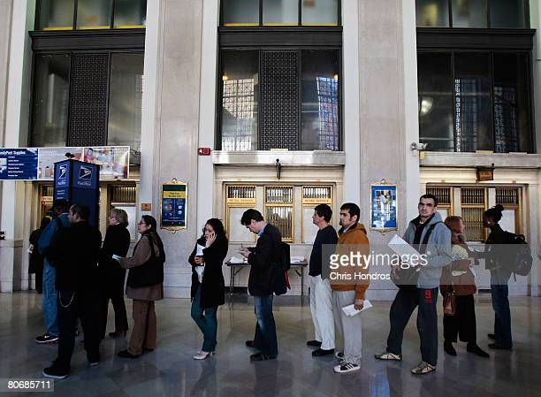 Citizens many of them holding tax forms line up in the lobby of the Farley Post Office April 15 2008 in New York City The Farley Post Office is New...