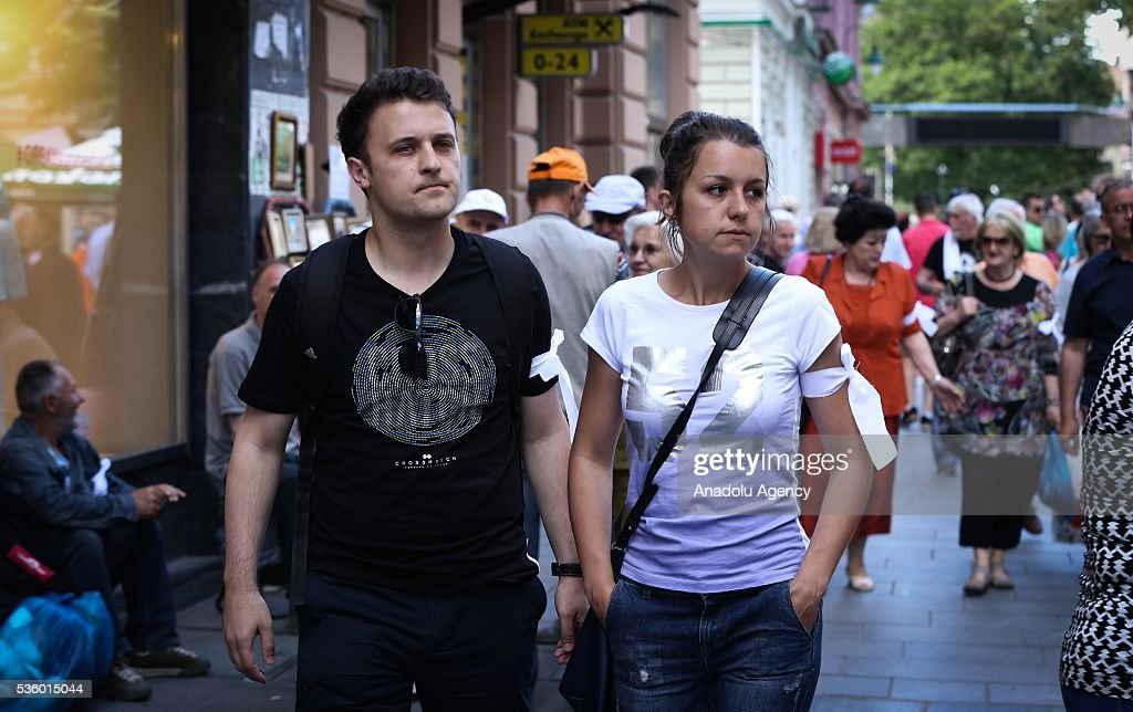 Citizens of Sarajevo in Bosnia and Herzegovina, wearing white ribbons on their arms, are seen during commemoration ceremony at the Cathedral of Jesus' Heart for non-Serb civilians killed in the war on the territory of western town of Prijedor, in Sarajevo, Bosnia and Herzegovina on May 31, 2016.