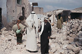 Citizens of the Jordanian West Bank town of Qalqilya examine their badly damaged homes after returning from Nablus during the Six Day War between...