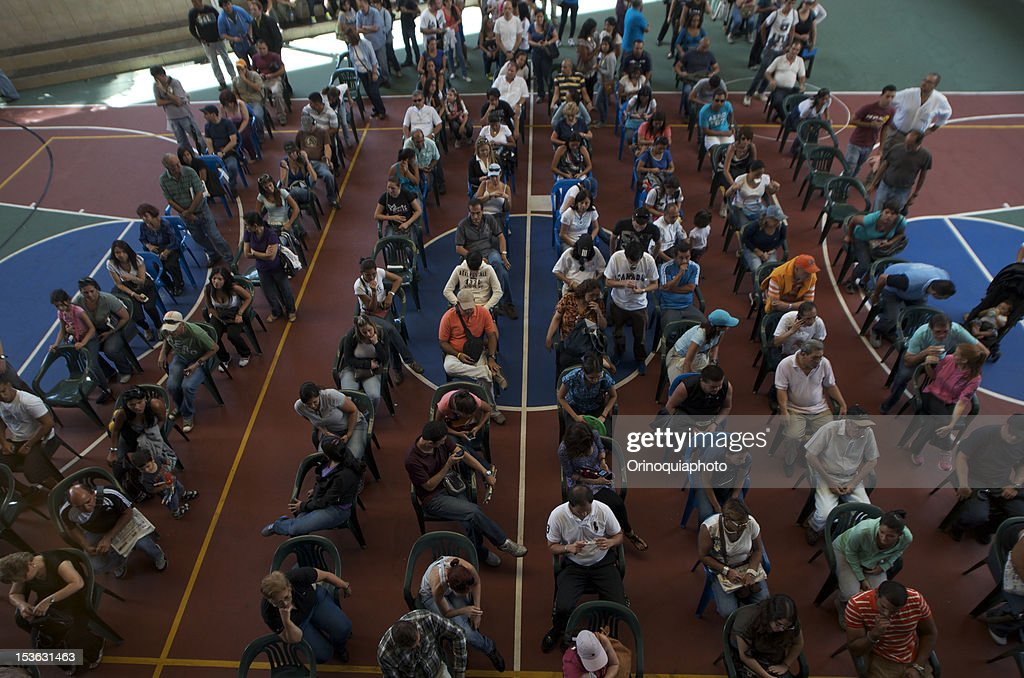 Citizens of Venezuela attend polls massively to choose president for 2013-2019, on October 07, 2012 in Caracas, Venezuela. Hugo Chavez seeks reelection against the candidate of the MUD party, Henrique Capriles.