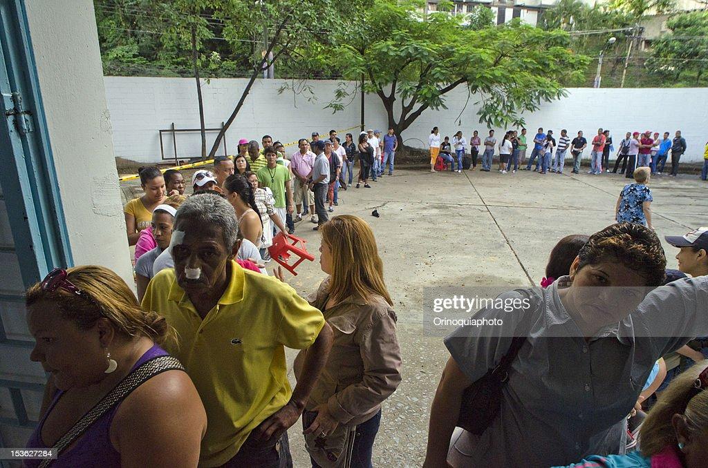 Citizens of Venezuela attend polls massively to vote for President on October 07, 2012 in Caracas, Venezuela.