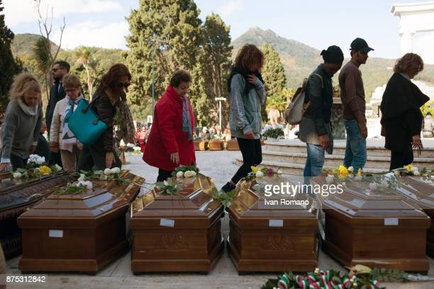 Citizens pay tribute to the bars of the migrant women in the Monumental Cemetery of Salerno on November 17 2017 in Salerno Italy A funeral was held...