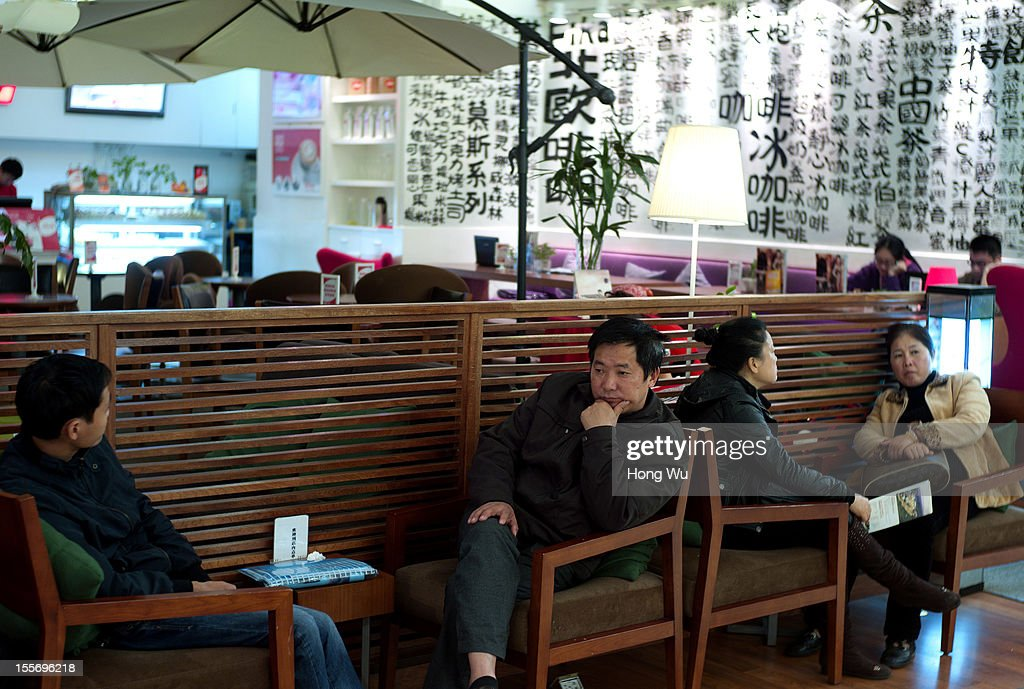 Citizens rest at a coffee bar at a shopping mall on November 6, 2012 in Chongqing, China.