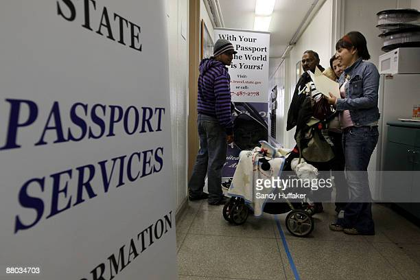 Citizens stand in line while filing for a passport at the San Ysidro Community Center on May 28 2009 in San Ysidro California Starting June 1...