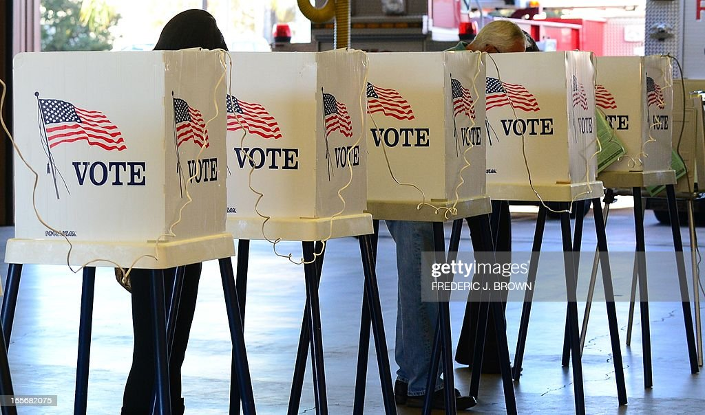 Citizens vote on Election Day at Fire Station in Alhambra Los Angeles County on November 6 2012 in California as Americans flock to the polls...