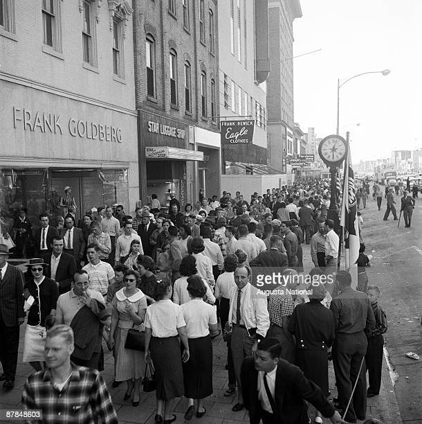 Citizens watch as floats move through downtown during the annual Masters Parade April 1959 in Augusta Georgia