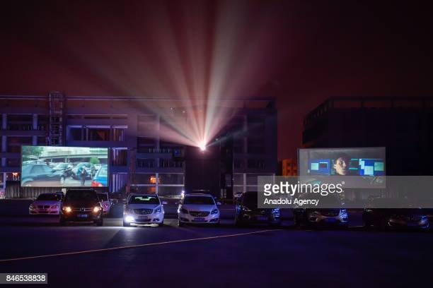 Citizens watch giant screen movies in their car at a drivein theater on September 13 2017 in Wuhan China A drivein theater or drivein cinema is a...