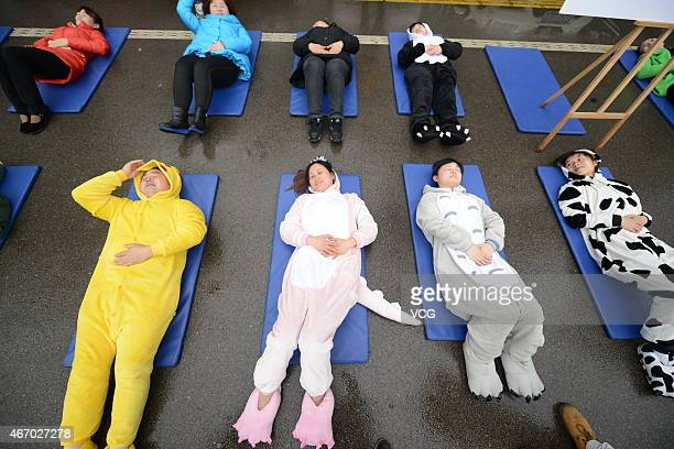 Citizens wearing cartoon pajamas show healthy sleep on March 20 2015 in Changsha Hunan province of China As the World Sleep Day comes citizens in...