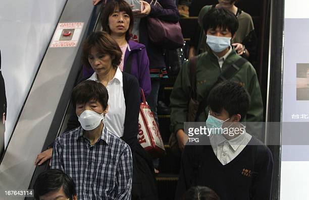 Citizens wore masks to protect themselves from H7N9 on Friday April 26 2013 in Taipei Taiwan China Taiwan Central Epidemics Command Center confirmed...