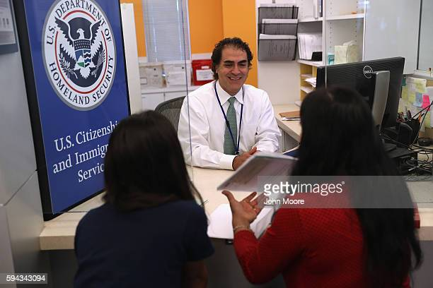 S Citizenship and Immigration Services officer interviews US citizenship applicants in the Dallas Field Office on August 22 2016 in Irving Texas The...